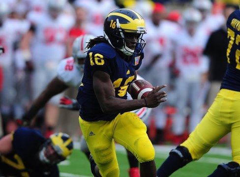 Nov 26, 2011; Ann Arbor, MI, USA; Michigan Wolverines quarterback Denard Robinson (16) runs with the ball during the second quarter against the Ohio State Buckeyes at Michigan Stadium. Mandatory Credit: Andrew Weber-US PRESSWIRE