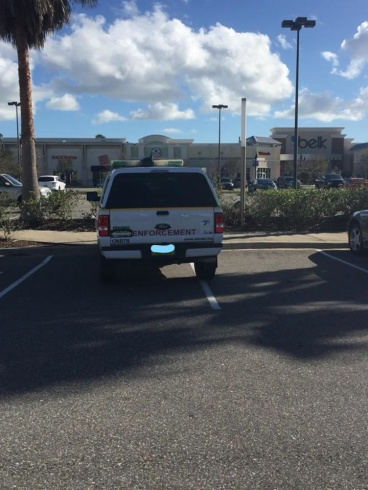 From Port Orange, Florida, here's your 306th Asshat of the Day! Hey, that's a government vehicle! Asshat thinks he's above asshat parking laws! Thanks to Asshat Patrol member Sara Alexander Fletcher for busting this asshat!