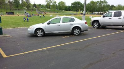 "From the Monroe, Ohio, here's your Asshat of the Day! This asshat is no only parked on the ""No Parking"" letters, he's blocking the entrance to the athletic field! Asshat indeed! Thanks to Asshat Patrol member Tessa Brown for today's asshat!"