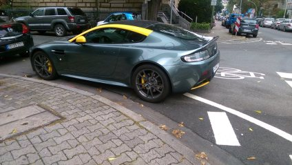 From Frankfurt, Germany, here's your 215th Asshat of the Day! We're worldwide, baby! Asshat thinks he can park his $300,000 Aston Martin Vanquish anywhere! Think again asshat! Thanks to Asshat Patrol member Todd Walker for today's asshat!