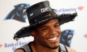 Carolina Panthers quarterback Cam Newton smiles while responding to a question during a press conference at the NFL football team's training camp in Spartanburg, S.C., Friday, July 29, 2016. (AP Photo/Gerry Broome) ORG XMIT: SCGB102