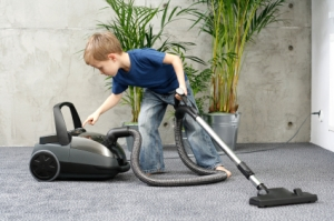 4-5 years old boy cleaning carper - housework