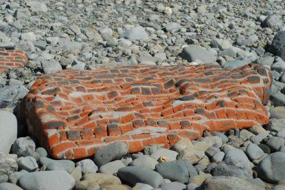 The ocean has worn down this brick wall.