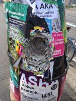 Concert posters on a pole.