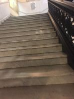 Steps worn from people sticking close to the railing.