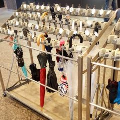 In Japan they have umbrella lockers so you don't have to walk around with them.