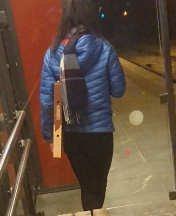 Why would you carry a pizza like this? WHY?