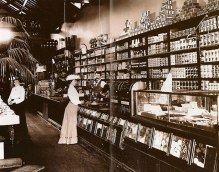 Here we have a store from 1897, when most women wore hats and men's mustaches were spectacular. And man, that lady has excellent posture.