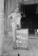Here we have a gent from Louisiana in 1938. Dude looks like he's daring some black dude to try and enter.