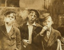 Three young Newsboys in St. Louis, 1910.