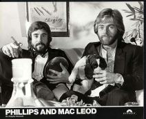Here's Phillips and MacLeod, inexplicably holding a football and a dog.