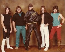 After spending all their money on the lead singer's jacket, the band Touche' went with a more basic look.